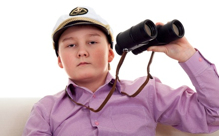 Strict boy with glasses and a cap Captain Stock Photo - 8558096