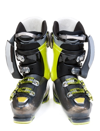 on skis: Pair green-dark ski shoe insulated on white background Stock Photo