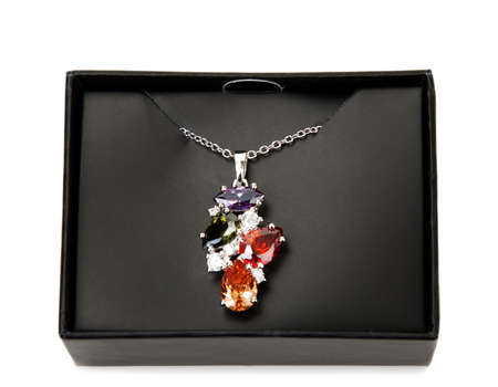 Necklace with precious stones in a black box photo