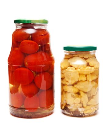 cymbling: Canned squash and tomatoes in glass jars on a white background Stock Photo
