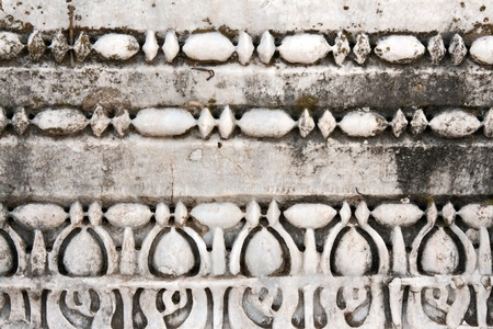Carved patterns in the old white marble photo