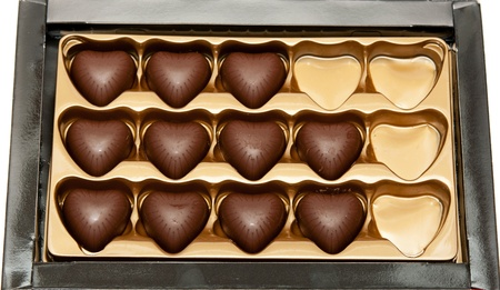 heart shaped: chocolates in the shape of a heart in a box