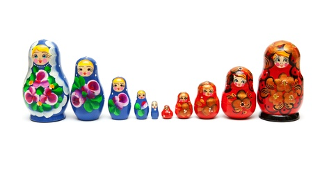 matroshka: Russian nesting dolls stand in a row on a white background
