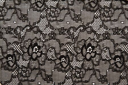 vintage lace: Background from black lace with pattern with form flower on white