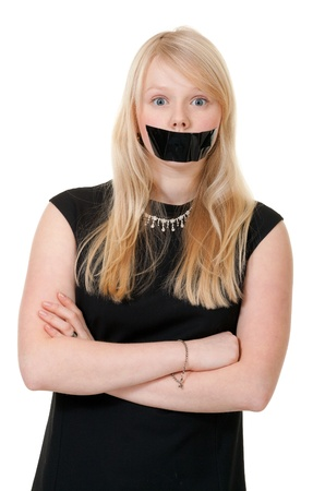 shut: beautiful girl with her mouth sealed with black tape Stock Photo