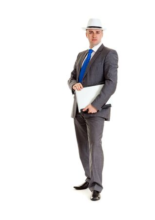 Young businessman in a suit and a hat with a laptop photo