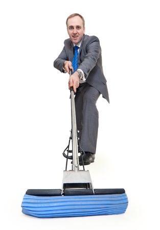 businessman with a mop washes the floor on a white background Stock Photo - 8699854