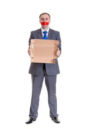 Businessman separates the red tape from his mouth photo