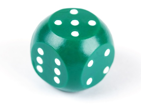 green plastic dice isolated on a white background Stock Photo - 8687209