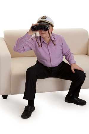 Strict boy with glasses and a cap Captain Stock Photo - 8791137