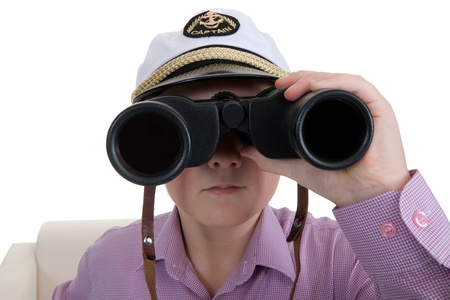 Strict boy with glasses and a cap Captain Stock Photo - 8791163
