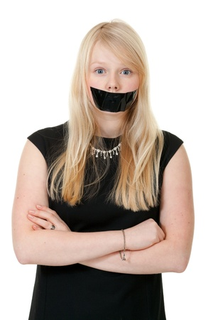beautiful girl with her mouth sealed with black tape photo