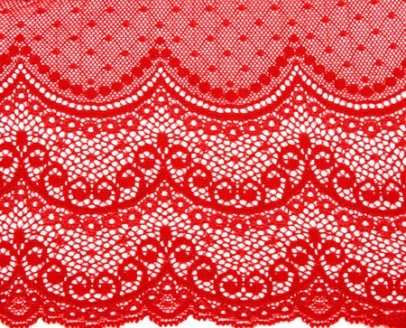 Decorative red lace on insulated white background photo