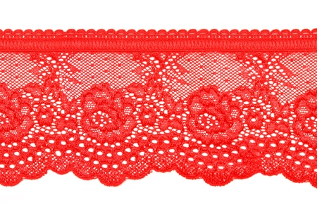 red lace with pattern in the manner of flower on white background photo