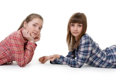 Two young beautiful girls lying on the floor