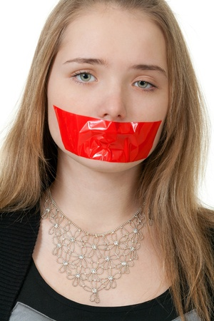 beautiful girl with her mouth sealed with red tape photo