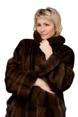 mink: portrait of a beautiful girl in a mink coat on a white background