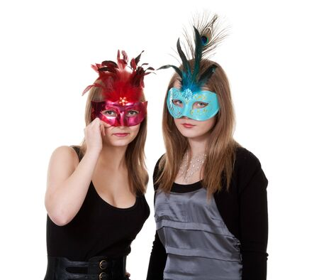 two girl in the masquerade mask on a white background photo
