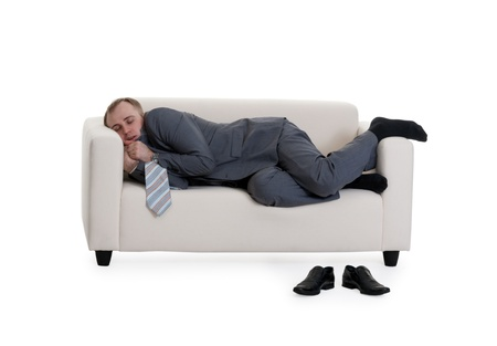 businessman sleeping on a sofa on a white background Stock Photo - 9051091