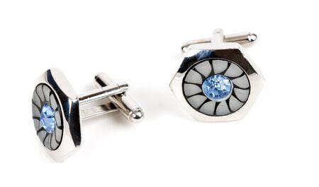 pair of platinum cufflinks with blue topaz isolated on white background photo