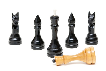 defeated: Chess Black defeated the bright king. Isolated on white background