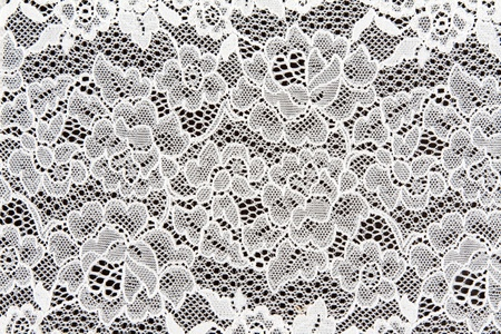lace background: White lace in the background on a dark