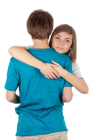 girl hugging guy isolated on white background Stock Photo - 9363827