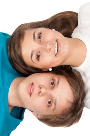 Boy and girl lying on white floor photo