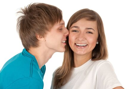 boy kisses a girl in studio on white background photo
