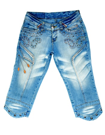 breeches: blue denim breeches with steel studs on white background
