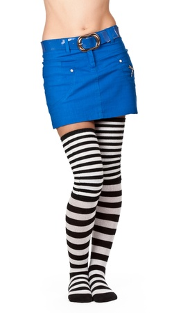 belly and female legs in striped socks and a blue skirt on a white background Stock Photo - 9615735