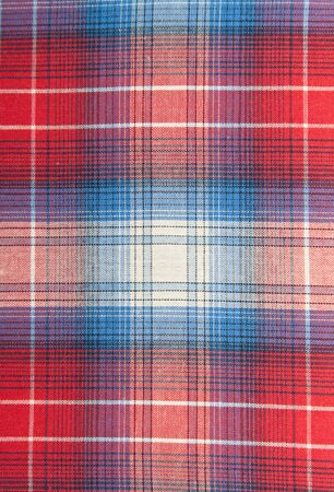background of red and blue plaid fabric photo