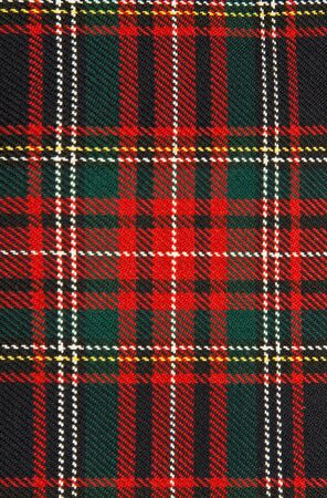 background of red and dark plaid fabric photo