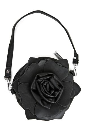 leather handbag in the shape of roses isolated on white background photo