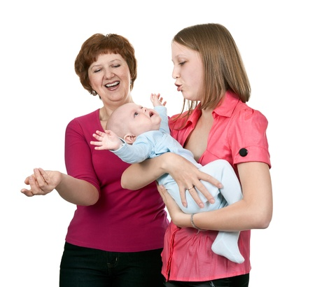 soothe: grandmother and mother soothe crying baby on a white background Stock Photo