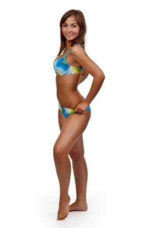 Beautiful tanned girl in a swimsuit on a white background Stock Photo - 9893291