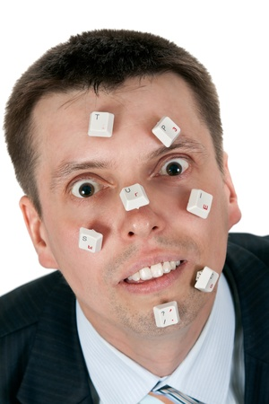 word STUPID vylodennoe buttons on the face of businessman on white background photo