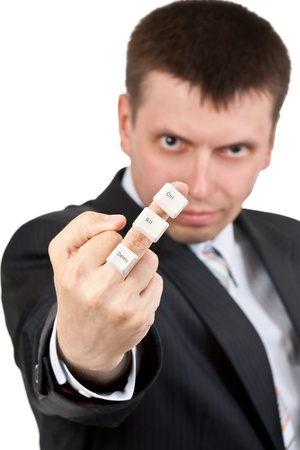 indecent: businessman shows Fuck. On the finger keys Ctrl Alt Delete on a white background. Shallow depth of field