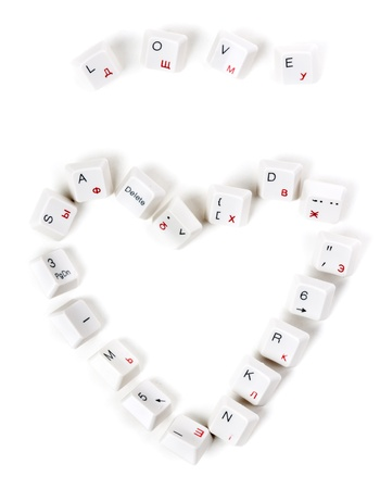word love and the heart laid out keys from the keyboard on a white background photo