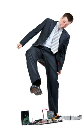 Businessman trampling foot motherboard on a white background Stock Photo - 10030808