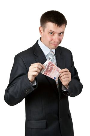 Businessman shows the two bills by ten euros on a white background photo