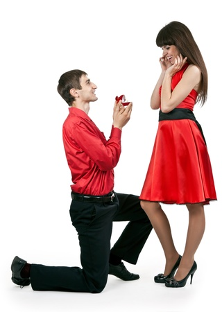 man gives the woman a ring on her knees photo