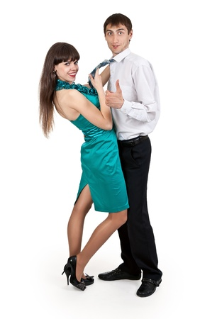 girl in a blue dress holds a businessman in tie