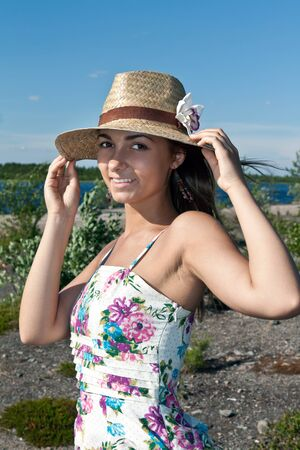 girl in a straw hat on the shore of Lake Stock Photo - 10061578