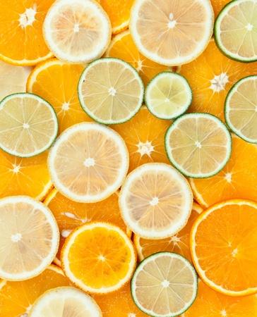 background of the slices of orange lemon lime photo