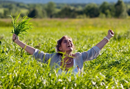 beautiful girl screaming in the grass Stock Photo - 10121177