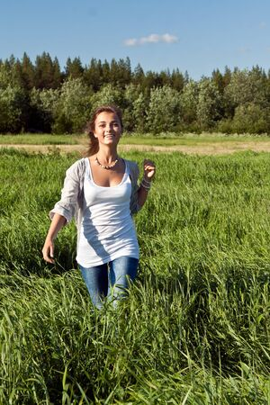 portrait of a beautiful young girl on green grass Stock Photo - 10120566
