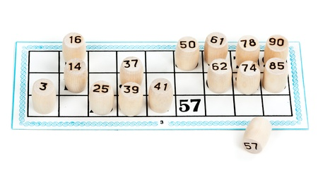 cipher: Wooden barrels lotto numbers on the card carton for the game Stock Photo