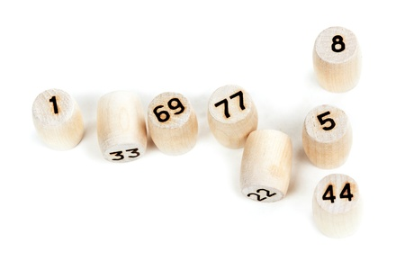 wooden barrels with lotto numbers on a white background photo