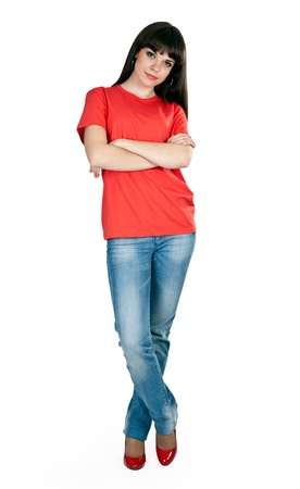 girl in red shoes and blue jeans in the studio on a white background